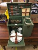 A green canvas picnic hamper, with inset wine cooler