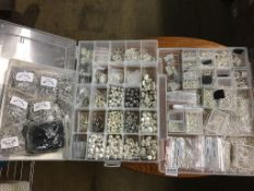 Two boxes of spacer beads and chains (large), and split rings and a box of 15 packets of silver