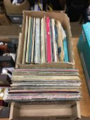 A box of LPs including Bowie, U2, Frank Sinatra, John Denver etc.