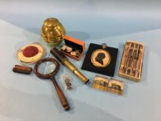 A Silhouette, small telescope, magnifying glass, two glass Harrogate paperweights, a British