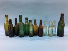 Twelve glass advertising bottles 'Gateshead' to include; 3 Dowson Brothers, 2 J. Kershaw, J.