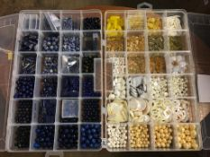 Two boxes of beads - lapis lazuli, quartzite, sodalite, citrine, shell etc.