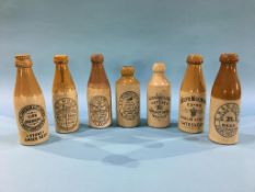 Seven stoneware advertising bottles; Longbothams, Malton, Rutherford and Co. Crook, W. and H. Roome,