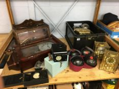 A shelf of assorted, including lawn bowls, wall clock, carriage clocks etc.