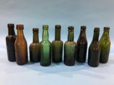 Nine glass advertising bottles of Sunderland to include Laing and Co., 2 Fenwick and Co., Elwen,