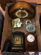 A box of assorted mantel clocks