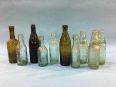 Ten glass advertising bottles; James Grieves, South Shields, Goodard and Reeve, Shildon, Four