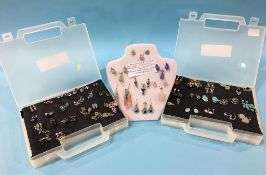 Seven silver sets of earrings with matching pendants and 40 pairs of silver earrings