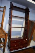 Mahogany open shelves, with four small drawers, 49cm wide