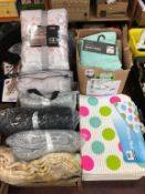 A large quantity of throws and bath mats (as new)