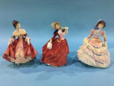 Three Royal Doulton figures 'Hannah', 'Southern Belle' and 'Autumn Breezes'