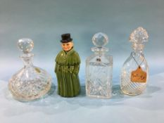 Three decanters and a Continental figural decanter