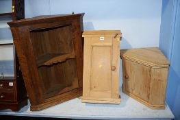 Pine wall cabinet, a corner cabinet and an oak cabinet