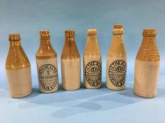 Six stoneware advertising bottles, M. Sutheran, Houghton le Spring, Tom Sutheran, East Rainton, G.