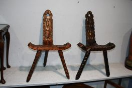 Two carved wood stools
