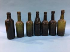 Seven glass advertising bottles 'Sunderland' to include; Elwen, T. Elwen and Son, R. Fenwick and Co.