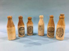 Six stoneware advertising bottles, Alexr Deuchar, William Row's, 'Tyneside Direct Supply', J.