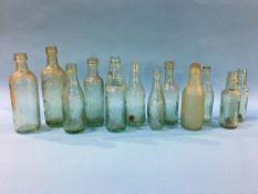 Twelve glass advertising bottles 'Gateshead' to include; Joseph Wilkinson, 3 J. Wilkinson, Wood