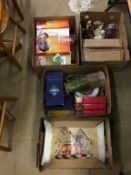 Four boxes of assorted glassware, Royal Doulton figures etc.