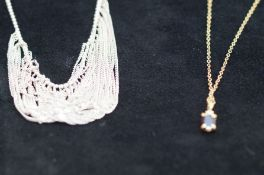 Gold plated chain with garnet pendant together wit