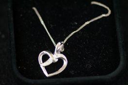9ct White gold chain & heart pendant