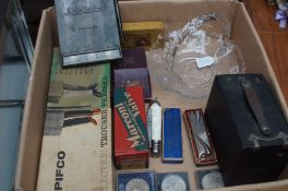 Box of vintage items to include a Hohner mouth org