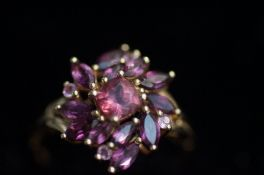 9ct Gold dress ring, set with pink stone cluster S