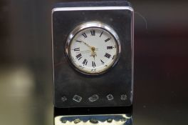Silver faced small mantle clock Height 7 cm