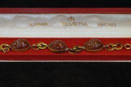 Gold plated bracelet, 3 skarb stones carved