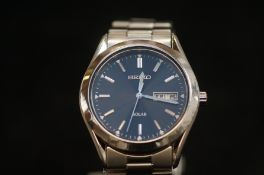 Seiko solar day/date wristwatch with outer box
