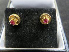Pair of 18ct gold & ruby earrings