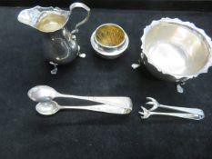 Collection of hallmarked silver sugar nips, cream
