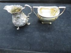 Silver cream jug with crowned leopards head togeth