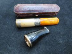 Cheroot holder with silver collars together with a