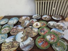 A large collection of cabinet plates