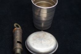 Scout whistle together with a stirrup cup in the f