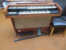 A Vintage Electric Pedal Organ