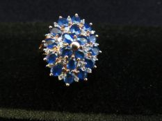 9ct Gold cluster ring set with blue & white stones