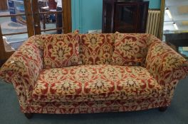 Large sofa with cushioned back and scroll arms, ra