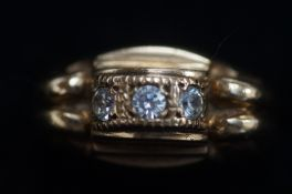 9ct Gold ring set with 3 white stones. Total weigh