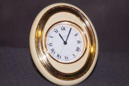 A Les Must De Cartier Paris travel clock numbered