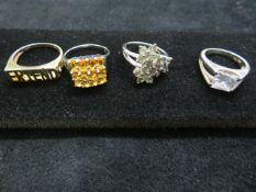 4 silver assorted dress rings