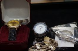 A collection of fashion watches to include a white