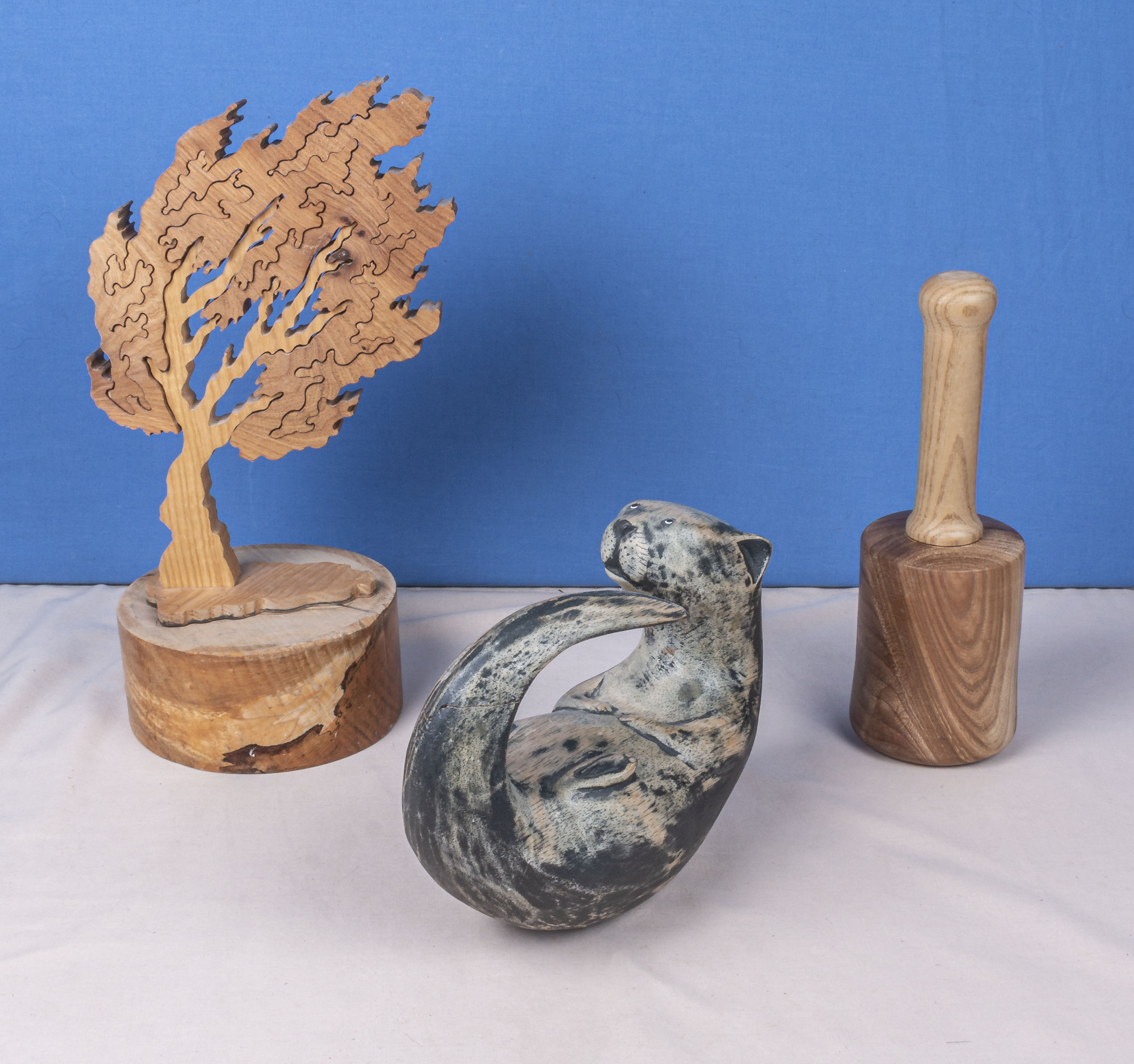 Lot 12 - A wooden puzzle tree, mallet and a cat