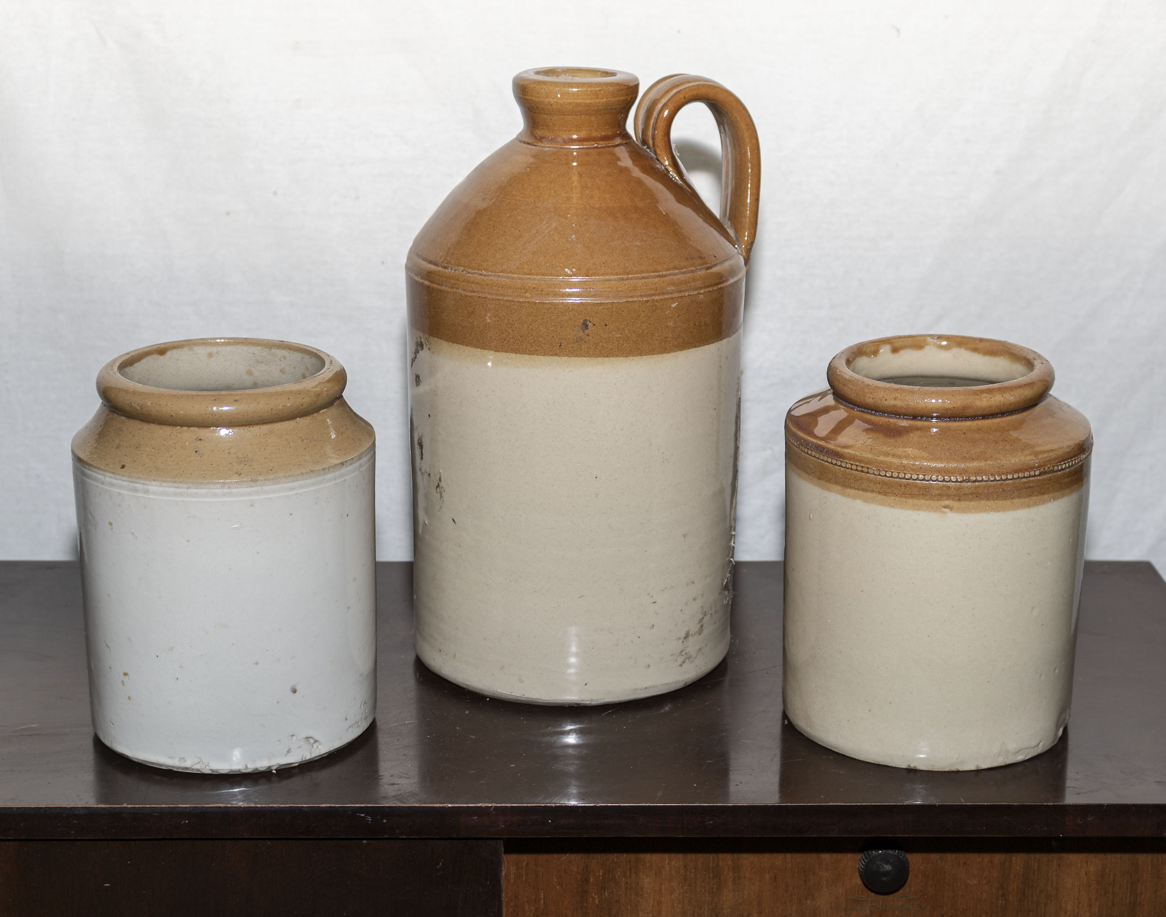 Lot 10 - Two stoneware jars and a bottle