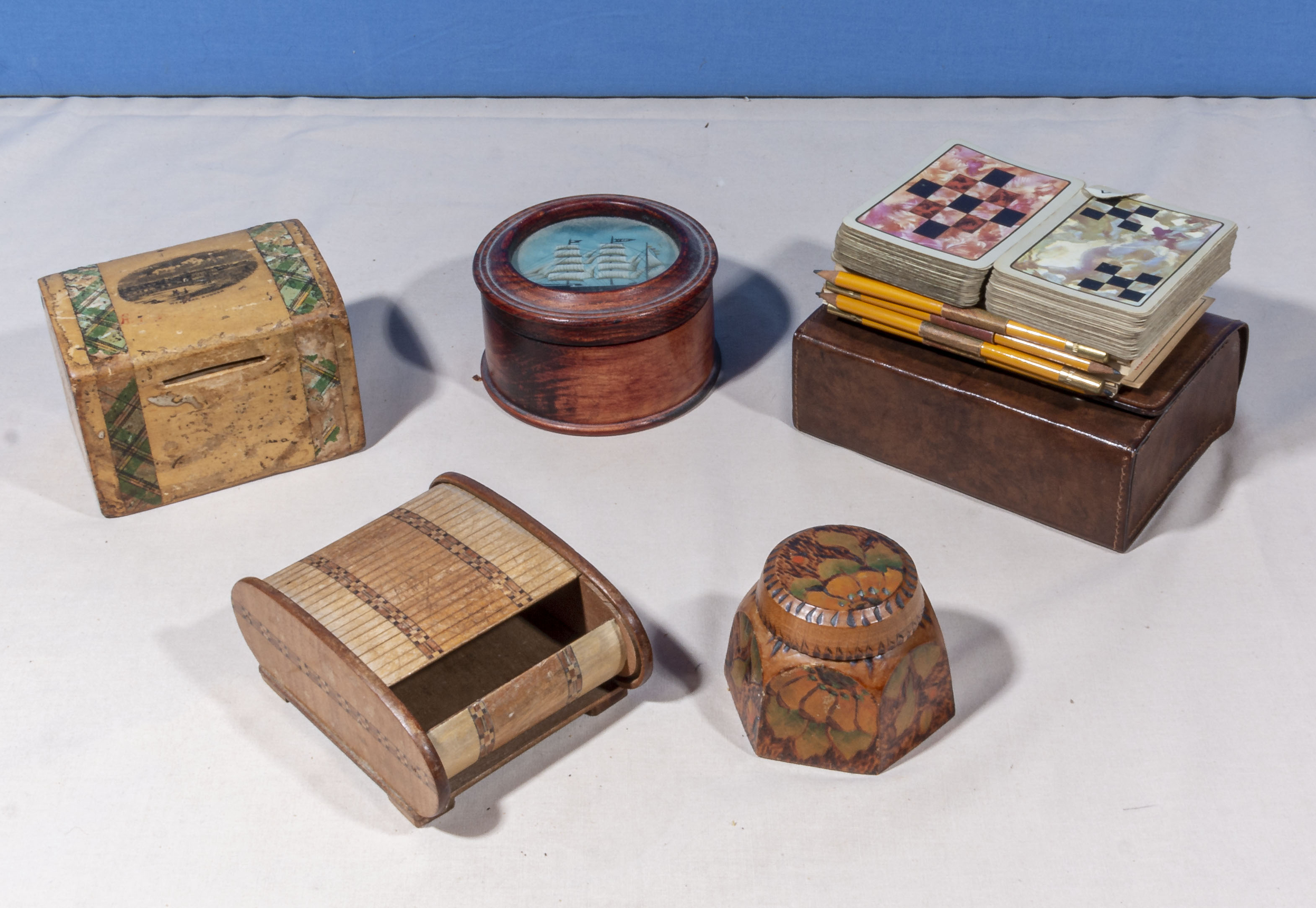 Lot 1 - Four pieces of treen and vintage playing cards
