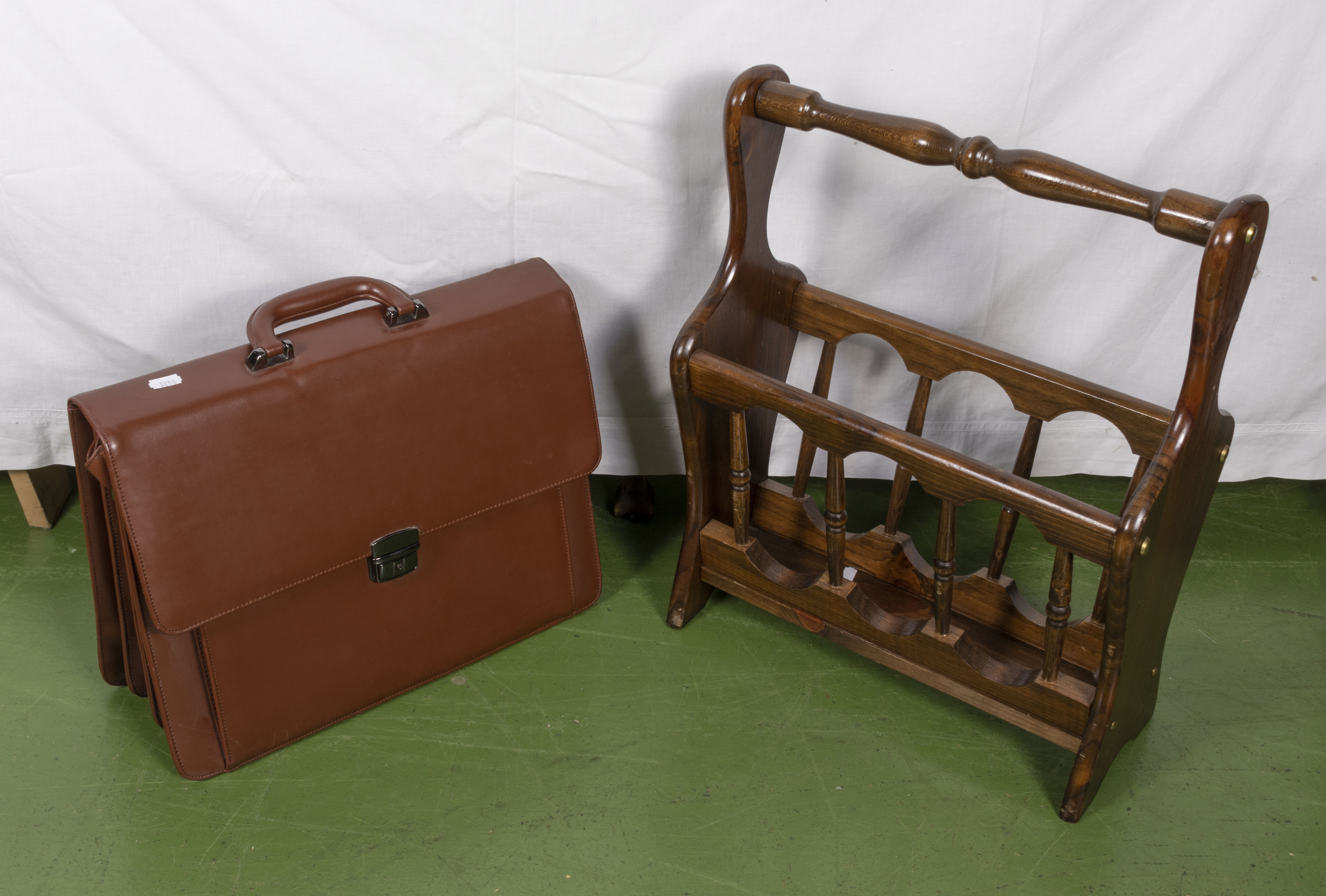 Lot 20 - A magazine rack and a briefcase