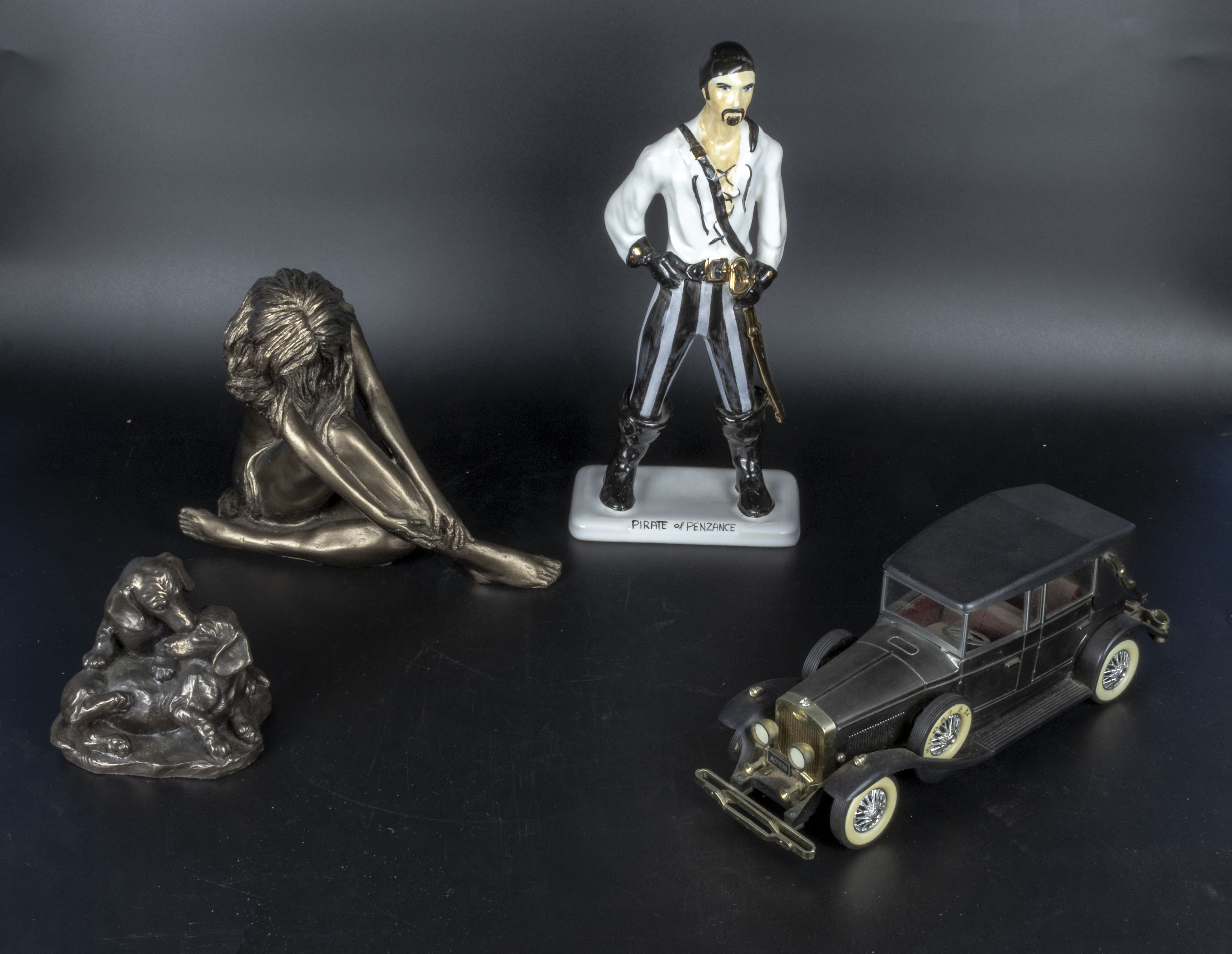 Lot 4 - Three figures and a model car
