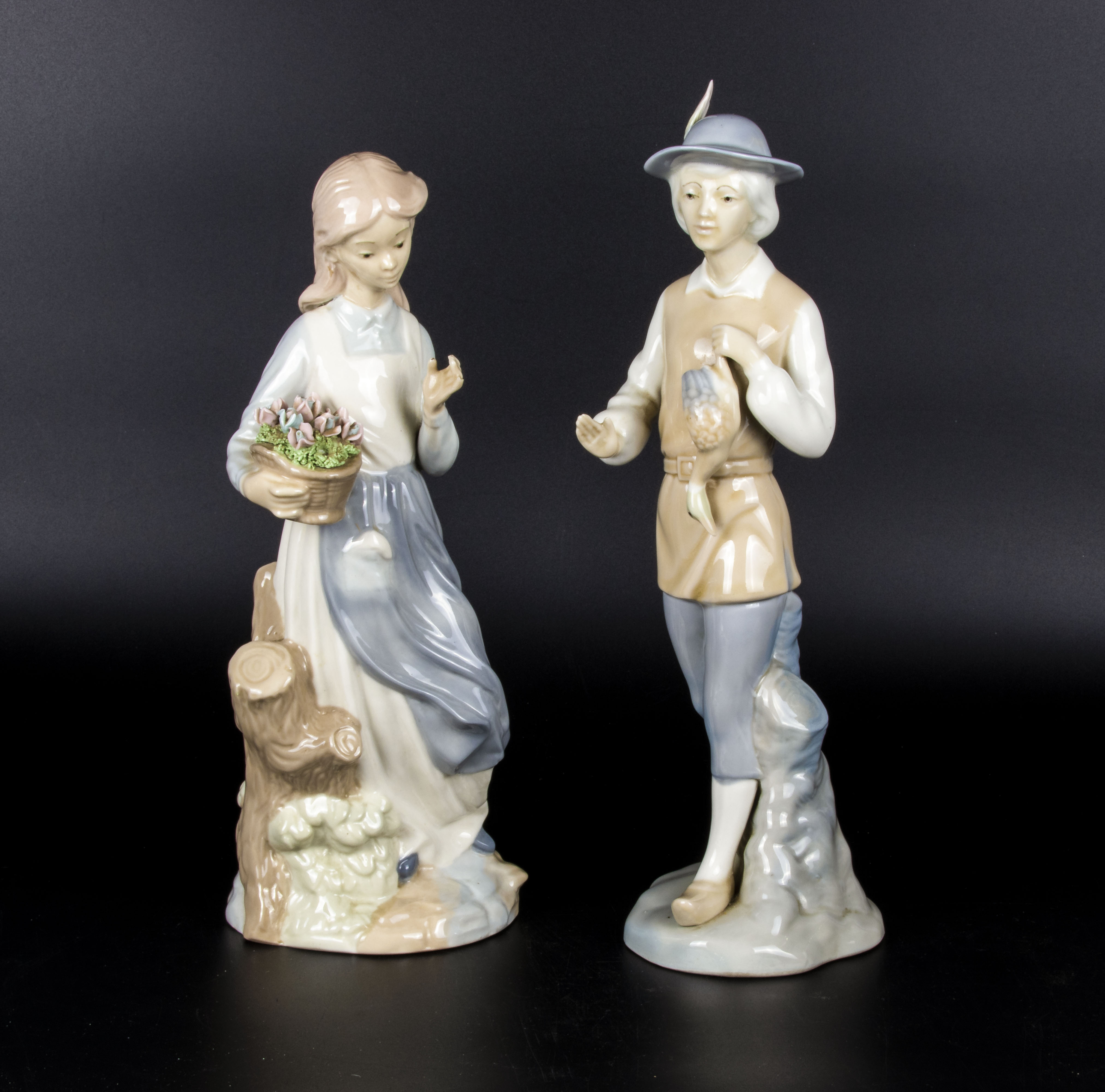 Lot 2 - A pair of Lladro figures