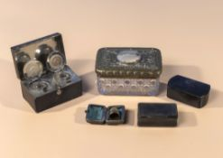 A travelling inkwell, thimble, two bone snuff boxes and a lidded glass box